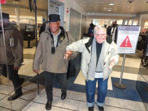 Lynne and Ralph coming through the gate at LaGuardia Airport.